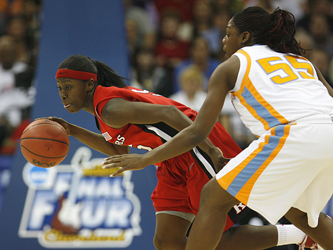 Essence Carson, who scored eight points for Rutgers, drives past Nicky Anosike.