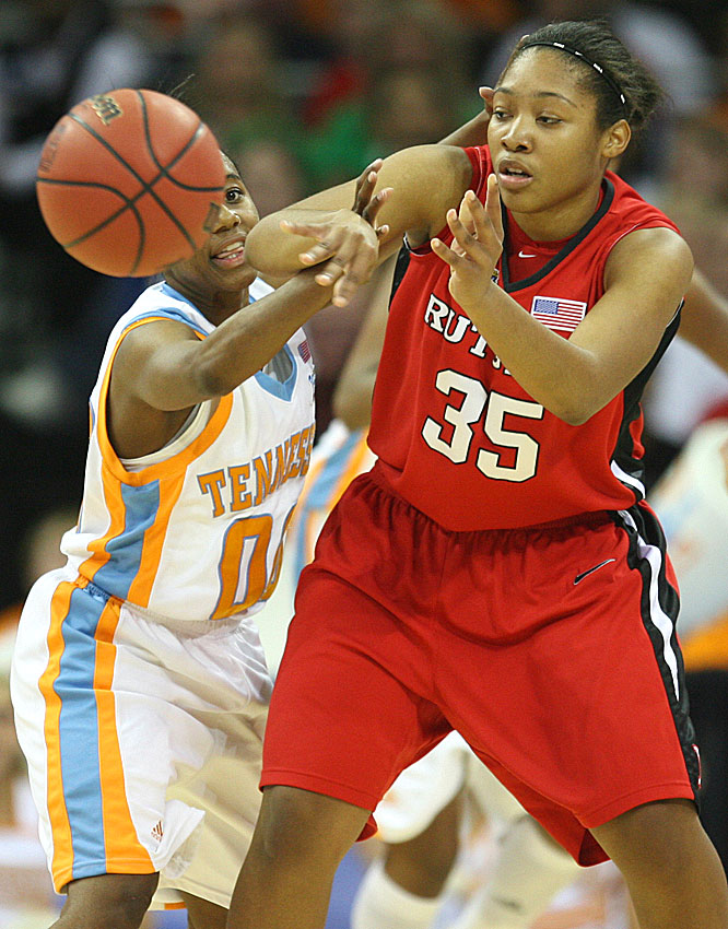 Rutgers' Brittany Ray looks to dish to a teammate as Tennessee's Shannon Bobbitt defends.