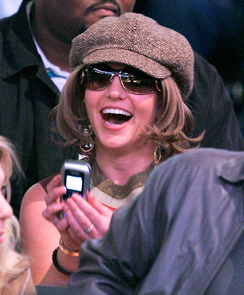 A happy and healthy looking Britney Spears took in Sunday's Suns-Lakers game at the Staples Center. Who was she texting? ...