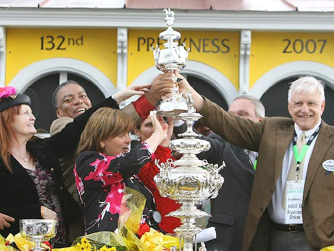 Members of Curlin's camp accept the Woodlawn Vase, the Preakness Stakes' official trophy, which is considered one of the most valuable in sports.