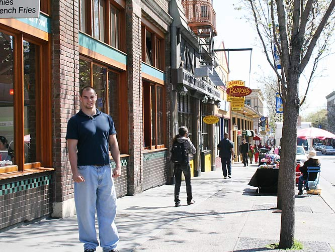 Kevin stands on the busy corner of Durant Avenue right below his apartment.