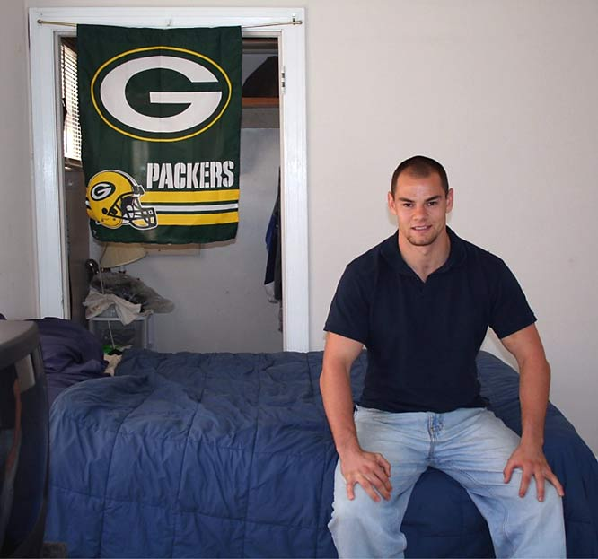 Kroll's apartment is rather simply decorated -- in fact the television and his double bed are among the few things that weren't left there by the previous tenant. Like any good Wisconsinite, though, he's a huge Green Bay Packers fan, and this flag separates his bed from his closet.