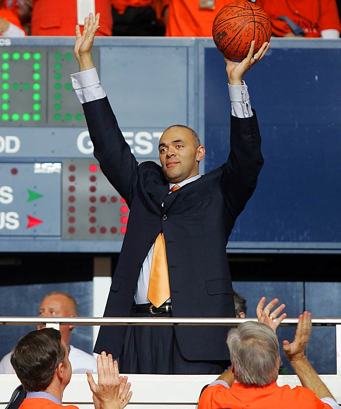 Men's basketball coach Dave Leitao holds up the last ball used at University Hall. The team moved to the newly constructed John Paul Jones Arena this past season.