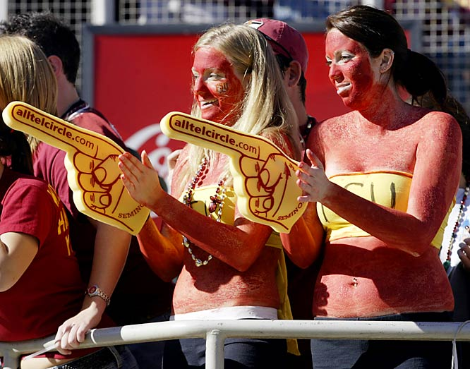 For the sake of these two fans, let's hope that's bodypaint and not a really bad sunburn.