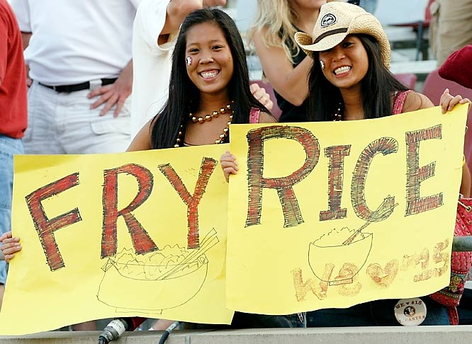 Two FSU fans implore the Seminoles to make short work of Rice when the two teams squared off last September.