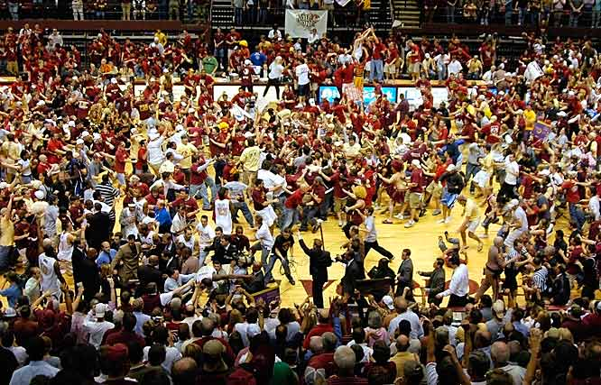 Fans rush the floor after the Seminoles upset top-ranked Duke in March 2006.