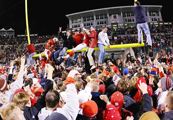 Wolfpack fans tore down the goalposts at Carter-Finley Stadium after defeating Florida State in November 2002.