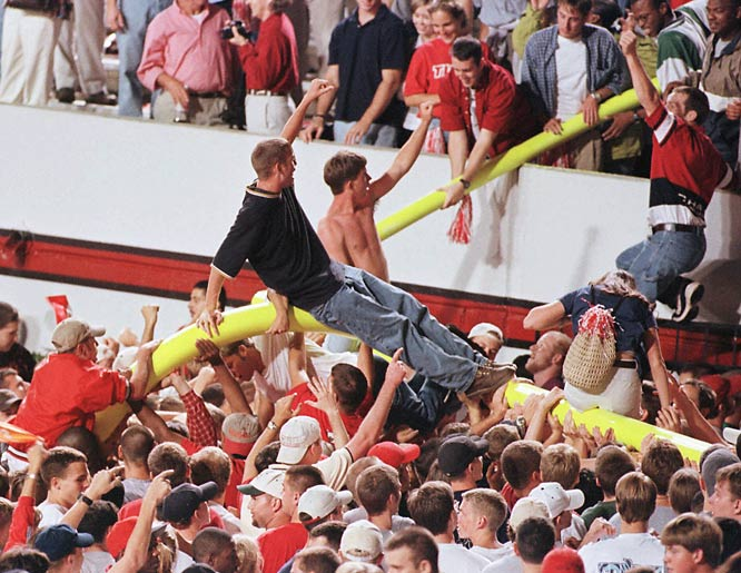 Fans rode the goalposts after a 38-17 victory over Syracuse in October 1998.