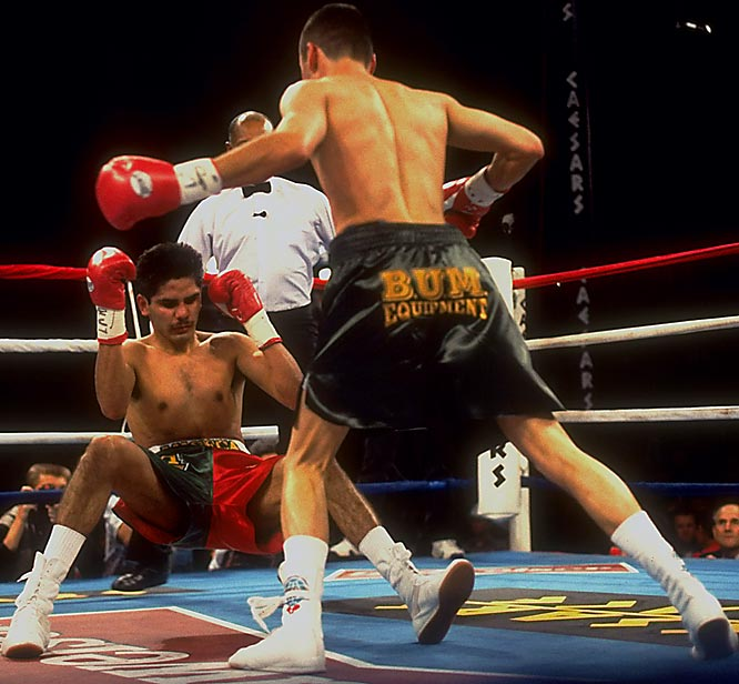 "Already the WBO lightweight champion, De La Hoya was gunning for the IBF version in only his 18th pro bout. The Mexican-born Ruelas, touted as a gritty challenger to the glitzy Golden Boy, promised an unrelenting attack. (Trainer Joe Goossen had said his fighter would be on De La Hoya like a ""soup sandwich."") De La Hoya dropped Ruelas twice in the second round, then battered him against the ropes until referee Richard Steele stopped the bout.<br><br>Visit SI.com for a live round-by-round of De La Hoya-Mayweather on Saturday."