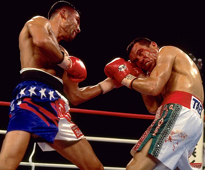 Just 23 and with a record of 22-0, De La Hoya was defending his WBC super lightweight title against his boyhood hero Chavez, who at 33 was a Mexican legend, a multiple world champ and veteran of 99 fights. Unfazed by the pro-Chavez crowd at Caesars Palace in Las Vegas, the kid sliced the old lion to ribbons in four cruel, bloody rounds.<br><br>Visit SI.com for a live round-by-round of De La Hoya-Mayweather on Saturday.