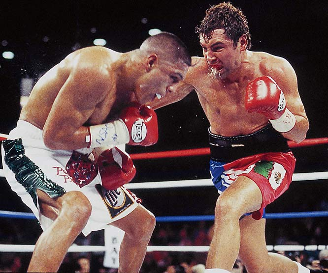 Since losing to Trinidad, De La Hoya had fought only four times, winning a couple more belts but also dropping another close decision, to Sugar Shane Mosley in 2000. Yet facing Vargas -- another product of Southern California's Mexican-American culture, who had called out the Golden Boy, questioning his machismo and street cred -- seemed to energize De La Hoya. Far from playing it safe this time, he beat the rugged Vargas at his own game, rocking him and bloodying him throughout and finally stopping him in the 11th.<br><br>Visit SI.com for a live round-by-round of De La Hoya-Mayweather on Saturday.