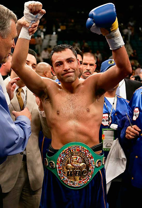 Twenty months after the only knockout loss of his career, De La Hoya made amends with a sixth-round TKO of Ricardo Mayorga in Las Vegas. The victory gave Oscar his 10th world title (in six weight classes).<br><br>Visit SI.com for a live round-by-round of De La Hoya-Mayweather on Saturday.