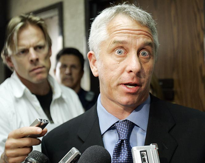 Greg LeMond speaks to the media after testifying against fellow cyclist Floyd Landis. Can somebody please loosen up the man's tie.