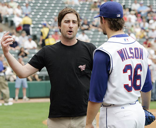 Owen Wilson has been seen lately with Kate Hudson at Golden State Warriors playoff games. His brother, Luke, is seen here with the pitcher C.J. Wilson at a Texas Rangers game. Advantage, Owen.
