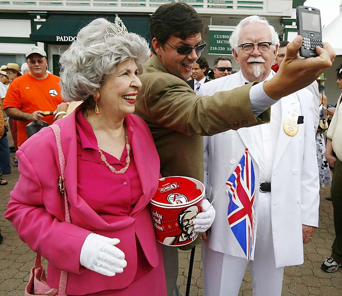 Two of the most famous people look-a-likes in the world, the Queen of England and Col. Sanders (of KFC fame), were roaming the crowds at Churchill Downs on Derby Day. The real Queen was also in attendance.