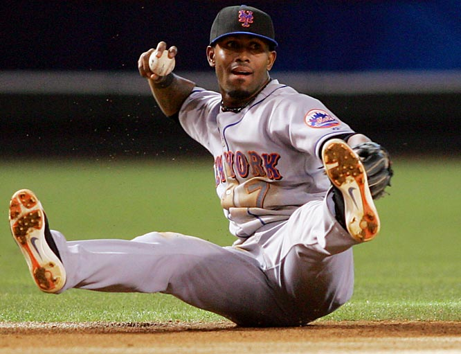 Mets shortstop Jose Reyes throws out Carlos Quentin after making a diving play to snare Quentin's one-hop smash in the eighth inning on Sunday.  The D-Backs won 3-1 to end a 13-game home losing streak to the Mets.