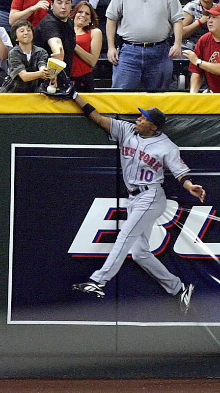 Mets leftfielder Endy Chavez keeps a ball hit by the D-Backs' Orlando Hudson in play in the eighth, but a fan's popcorn box appeared to touch the ball over the wall, resulting in a two-run homer for Hudson.  The Mets held on to win the game 5-3 on May 4.