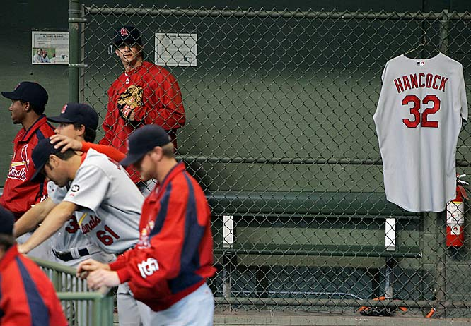 Cardinals' reliever Tyler Johnson (61) reacts after hanging up former teammate Josh Hancock's jersey in the bullpen at the start of a 7-1 loss to the Brewers on April 30.  Hancock died in a car crash on April 29.