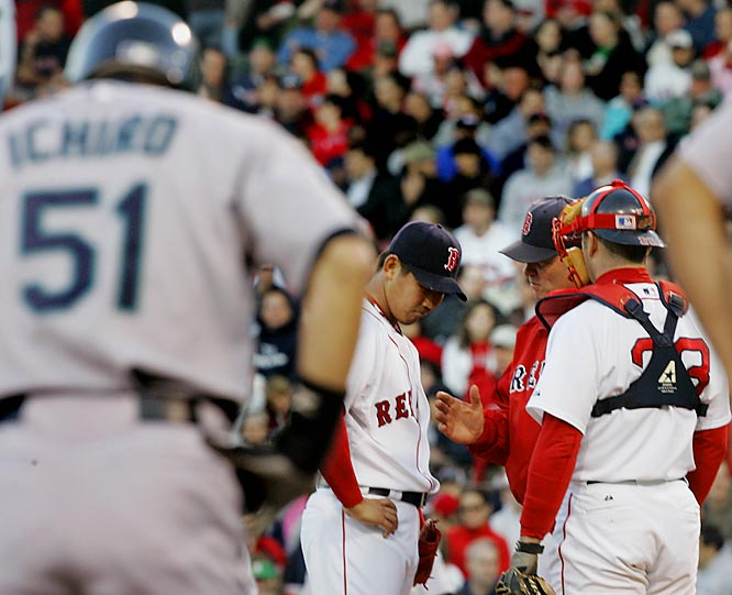 Red sox pitching coach John Farrell talks with pitcher Daisuke Matsuzaka after he walked the first three batters to load the bases in the first inning against the Mariners on May 3. Dice-K proceeded to allow five runs in the first and seven runs through five innings.
