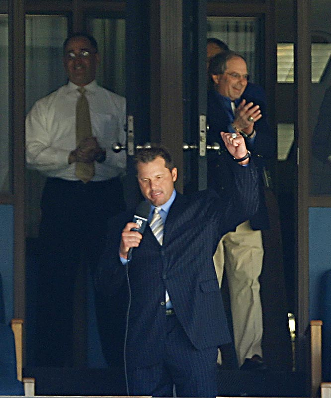 Roger Clemens announces his return during the seventh-inning stretch of the Yankees 5-0 victory over the Mariners on Sunday. The 44-year-old pitcher spoke to fans from the owner's box as a crowd of 52,553 at Yankee Stadium looked on.