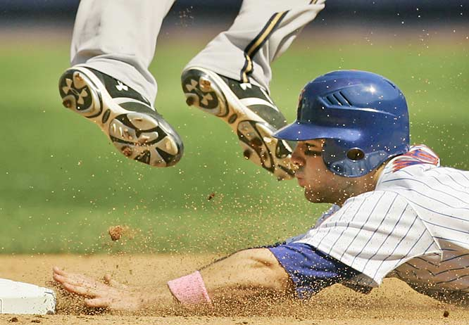 The Mets' David Wright steals second beneath the spikes of Brewers second baseman Rickie Weeks during a 9-1 win on Sunday. More than 200 players wore pink wristbands and swung pink bats for breast cancer awareness on Mother's Day.