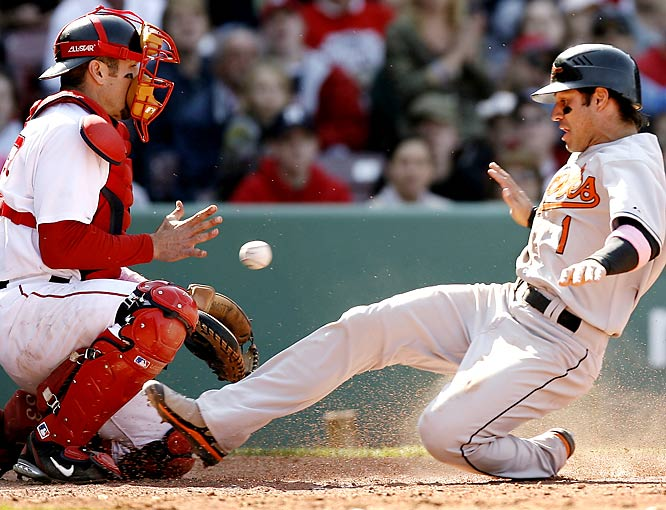 Red Sox catcher Jason Varitek gets a late throw as Baltimore's Brian Roberts slides home safely during a May 13 game at Fenway.