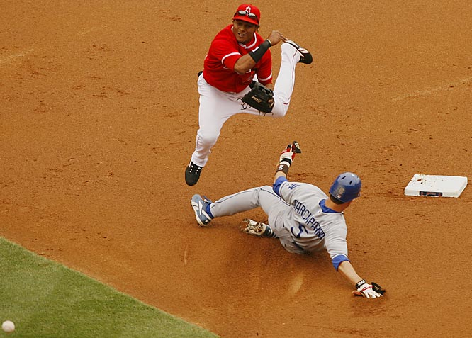 Angels second baseman Erick Aybar turns a double play after forcing out the Dodgers' Nomar Garciaparra in the first inning on May 20. The Angels won 4-1 to sweep the Dodgers in the Battle of Los Angeles.