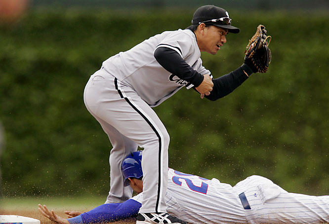 The Cubs' Angel Pagan slides safely between the legs of White Sox second baseman Tadahito Iguchi in the first inning on May 20. The White Sox won 10-6.