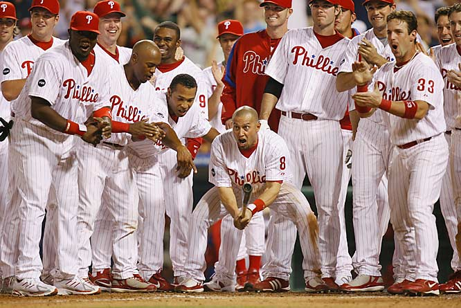 Shane Victorino (8) and his teammates wait for Carlos Ruiz to cross the plate after a solo homer in the bottom of the ninth gave the Phillies a 4-3 victory over the Brewers on May 15.