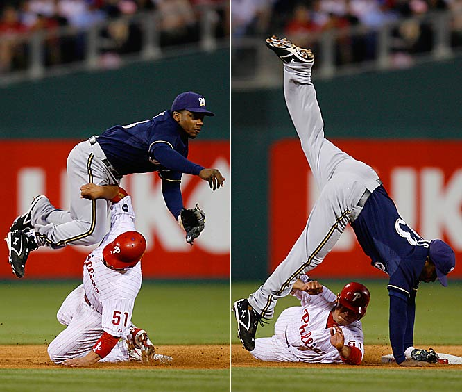 Brewers' second baseman Ricky Weeks turns a double play as the Phillies' Carlos Ruiz takes his legs out from under him during a May 15 game.