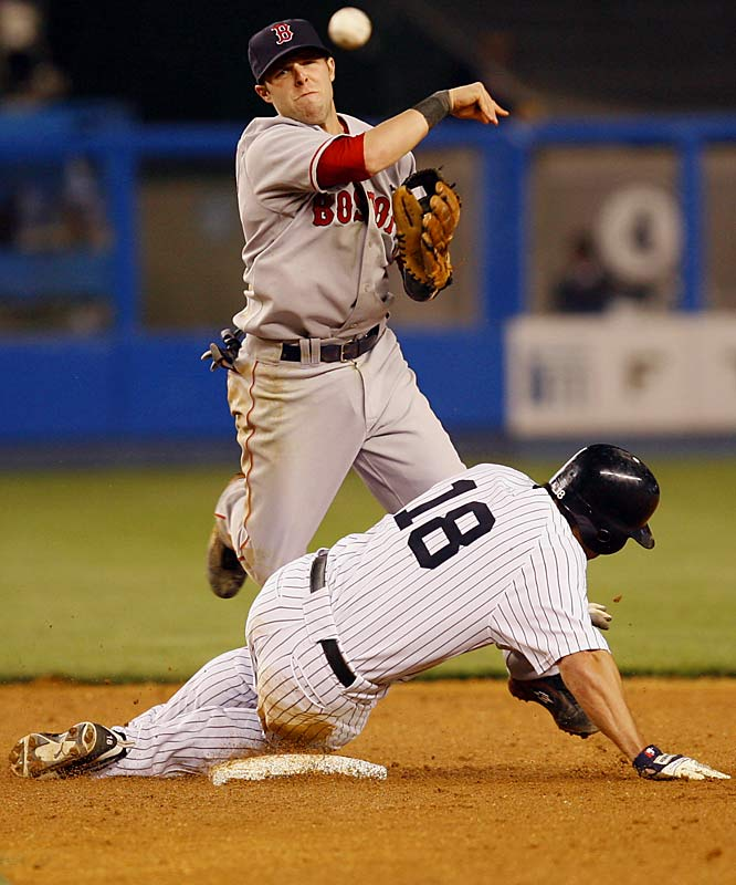 Red Sox second baseman Dustin Pedroia fails to turn a double play after forcing out the Yankees' Johnny Damon in the fifth inning on May 22. Boston won 7-3.