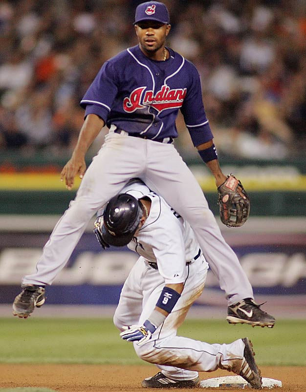 Indians second baseman Josh Barfield lands on the Tigers' Carlos Guillen after turning a double play in the eighth inning on May 25. Cleveland won 7-4.