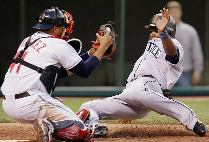 Cleveland's Victor Martinez tags Jose Guillen out to end the fifth inning on May 21. Cleveland won 5-2.