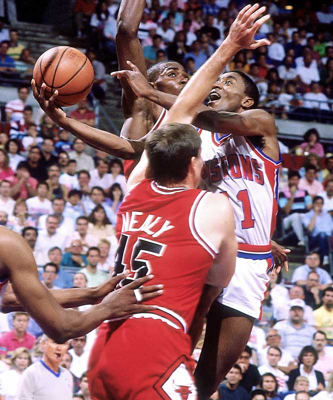 Thomas wasn't just one of the best all-time small men; he's one of the greatest players, period. A dynamic scorer, Thomas led the Pistons to back-to-back championships at a time when Magic Johnson and Michael Jordan were each at their apex as all-time great players. He averaged 20 points and 10 assists for four straight seasons, then sublimated his game so that the Pistons could become a defensive juggernaut.