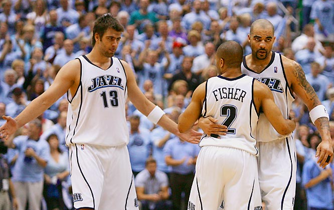 Mehmet Okur and Carlos Boozer welcomed back teammate Derek Fisher with open arms after he missed most of the first three quarters while returning from New York, where his 10-month old daughter underwent surgery for eye cancer. Fisher scored all five of his points in OT to lead the Jazz to victory over the Warriors.