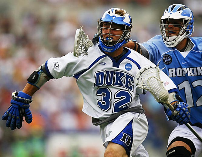 Duke midfielder Sam Payton gets slashed by Johns Hopkins midfielder Stephen Peyser.