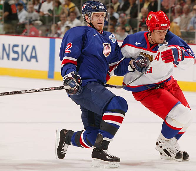 With the NHL players locked out and the 2004-05 season in jeopardy, Leetch skated for the U.S. at the 2004 World Cup. Here, he battles former Ranger teammate Alexei Kovalev of Russia.