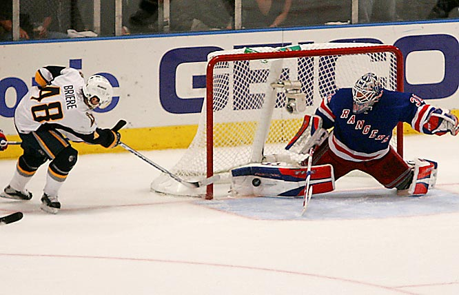 Rangers goalie Henrik Lundqvist stops Daniel Briere's shot just short of fully crossing the goal line with 17 seconds left to hold on for the win and even the series 2-2.