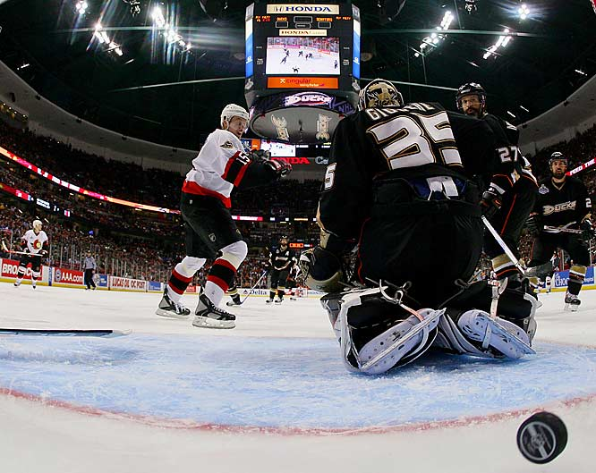 Ottawa took a 2-1 lead after goalie Jean-Sebastien Giguere lost his stick and was beat high to the stick side by a wobbling shot from defenseman Wade Redden on the power play.