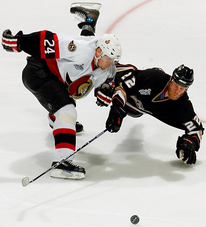 Sens defenseman Anton Volchenkov keeps Ducks center Todd Marchant off the puck in the third period.  Volchenkov led Ottawa in ice time (24:57), blocking a game-high 10 shots in the Senators loss.