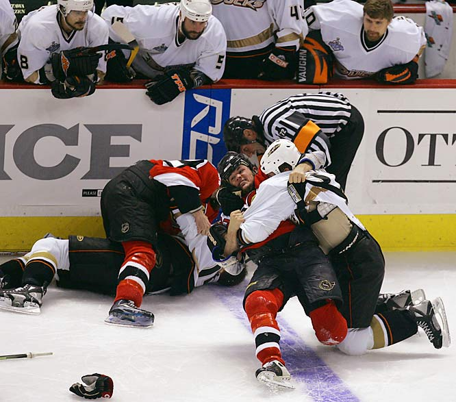 The Senators Mike Fisher grapples with Ryan Getzlaf during a full-force scrum in the third period.  Fisher's and Getlzaf's lines were sent to the penalty box with roughing minors.