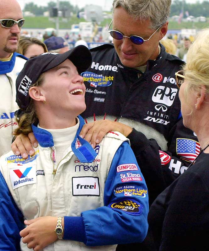 Fisher and Eddie Cheever share  a laugh prior to the 2000 Belterra Casino Resort Indy 300 in Kentucky. Fisher became the first woman to win the pole in a major auto racing series when she pulled off the feat at the Belterra in 2002.
