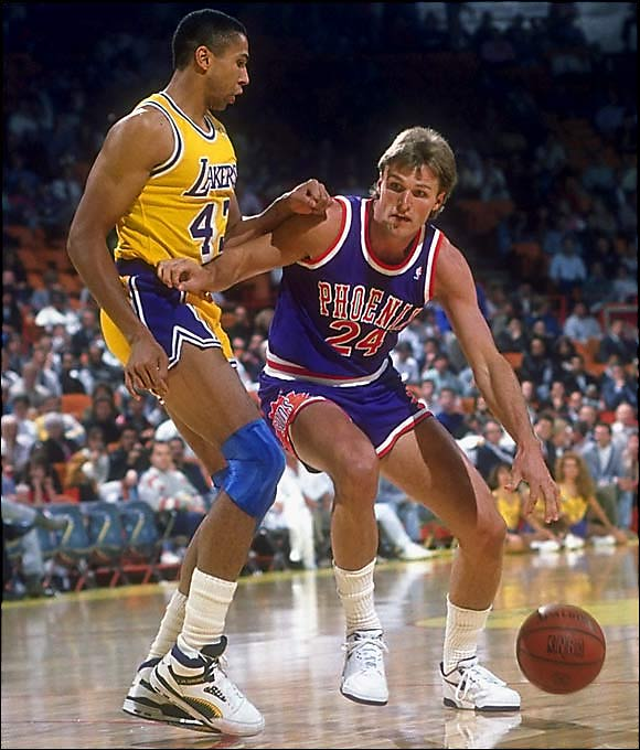 The pre-Charles Barkley Suns (54-28), featuring Tom Chambers (left) and Kevin Johnson, were decided underdogs against MVP Magic Johnson and the top-seeded, 63-win Lakers. But after splitting the first two games, the Suns took three straight to win the series. The Suns advanced to the conference finals, where they were promptly dismissed by Portland.