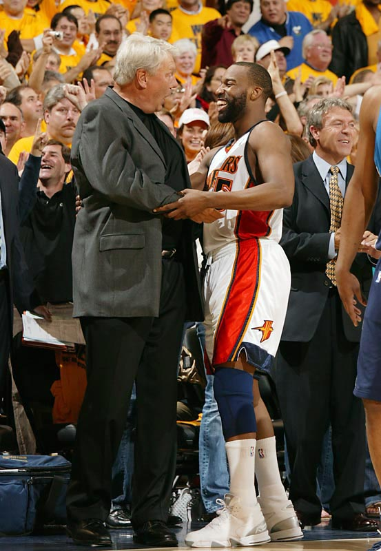Coach Don Nelson, shown here with Baron Davis, guided the Warriors to a 9-1 finish just to make the playoffs on the final day of the regular season. Nelson topped that in the first round by tormenting a Mavs team he coached for eight seasons.