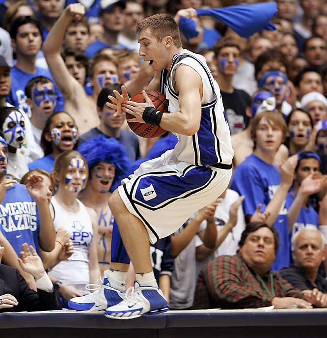 Greg Paulus shows off his athleticism for fans in the front row.