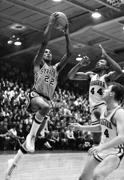 In three varsity seasons, Bing led the Orange in scoring with 24.6 points per game. He earned All-American honors as a senior before being drafted second-overall by the Detroit Pistons. He was also the first Syracuse player to have his number (22) retired.