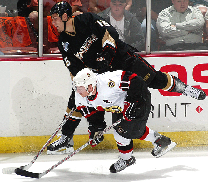 Ryan Getzlaf tries to get around Daniel Alfredsson during the first period.