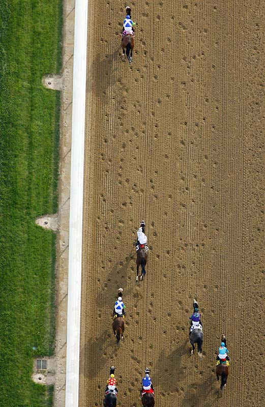 "SIMON SAYS:   ""This was last year's Kentucky Derby, shot from the MetLife blimp. It's Barbaro pulling away on the finishing stretch. It's a great angle. Problem is, the MetLife blimp isn't there for me: it's there for TV. The TV setup has this incredible lens and zoom on the front of the blimp, and it's remote-controlled by a guy in the back.  I was sitting with him in the back, trying to squeeze over the pilot's shoulders to shoot where and when I can out of a small window. I shot this with a 500mm lens with a 1.4x converter, making it a 700mm lens. It's definitely hit-or-miss at this height with this long lens on a horserace, and I was lucky enough to get this photograph out of it.""  Shot with a Canon EOS-1D Mark II N, EF 500mm f/4L IS USM with a 1.4x converter (to 700mm) f5.6"