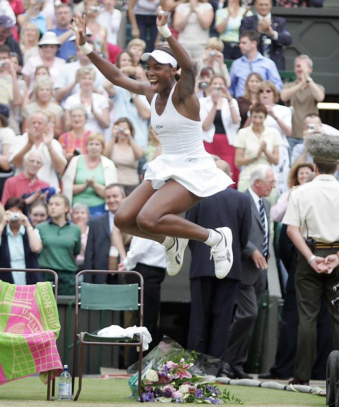"SIMON SAYS:   ""I was courtside here at the ladies' Wimbledon final in 2005. No one had expected Venus Williams to get to the final, let alone to win it. (She beat Lindsay Davenport in three sets.) Raw emotion is what you're looking for at these big finals, and Venus's reaction typified what you're after.""  Shot with a Canon EOS-1D Mark II, EF 200mm f/2.8L II USM"