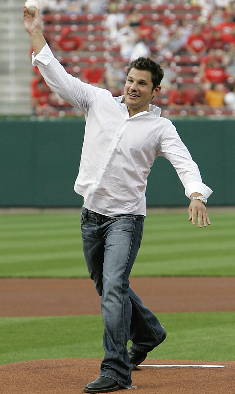Nick Lachey threw out the first pitch at Thursday night's Cardinals-Reds game. It's good to see that the USC fan still makes time for teams that stink.
